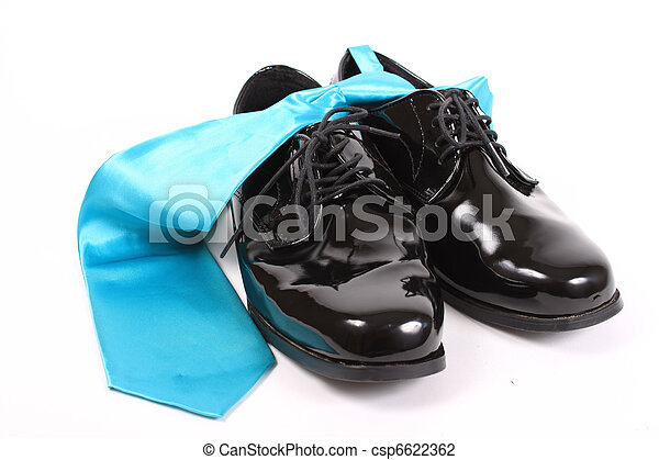 Shiny mens dressy shoes and blue tie - csp6622362