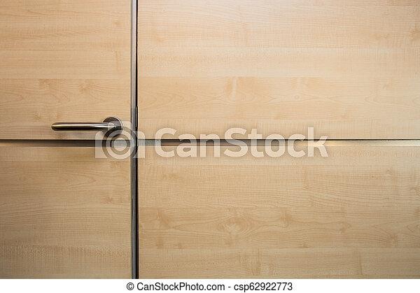 Shiny wooden door and wall texture background modern design - csp62922773