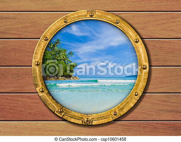 ship porthole with tropical island behind - csp10601458