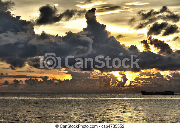 Ship with threatening clouds over South China Sea at Phu Quoc, Vietnam - csp4735552