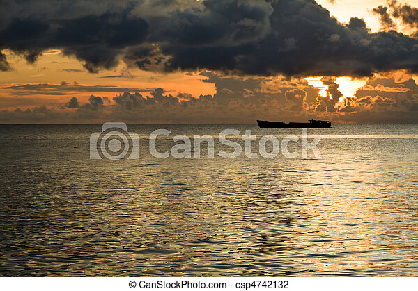 Ship with threatening clouds over South China Sea at Phu Quoc, Vietnam - csp4742132