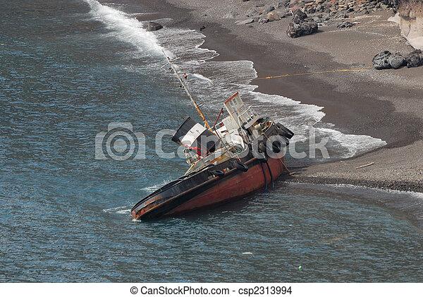 Ship wreck on the coast of Santorini, Greece - csp2313994