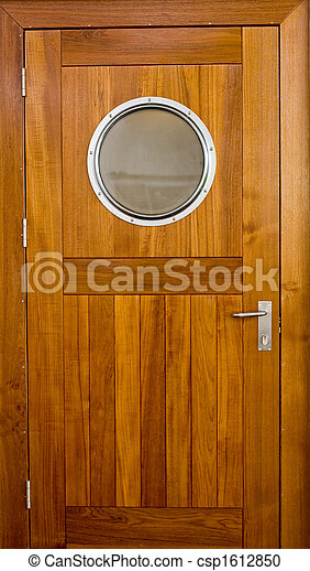 Ships Door - csp1612850 & Ships door. Wooden door with a porthole on a ship.