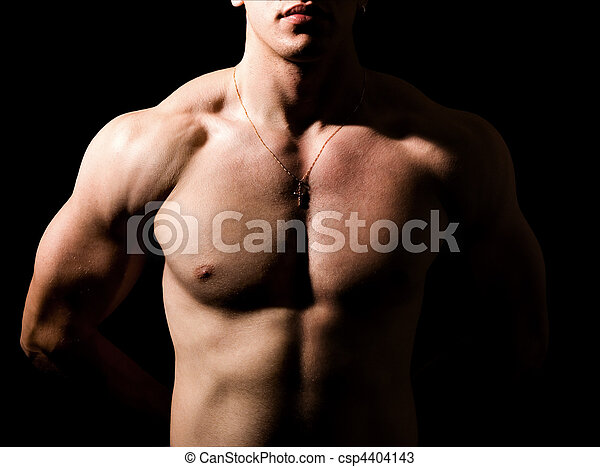 Shirtless man with muscular sexy body in the dark - csp4404143