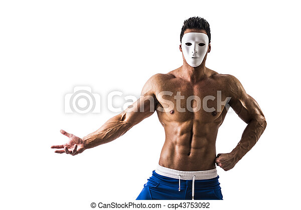 Shirtless muscle man with creepy, scary mask on tilted head - csp43753092