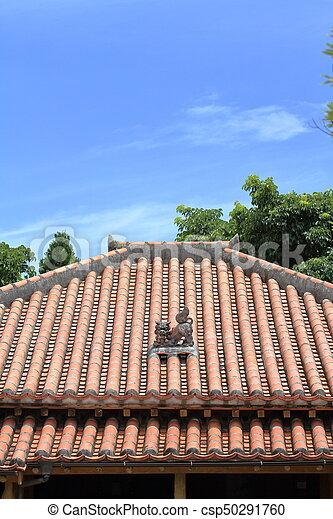 Shisa (guardian from Kingdom of Ryukyu) on the roof in Okinawa, Japan - csp50291760