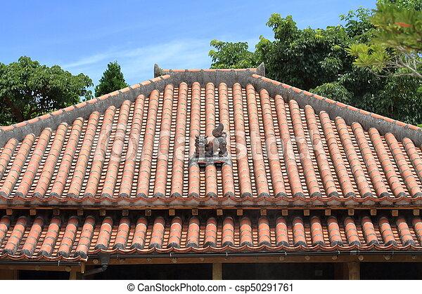 Shisa (guardian from Kingdom of Ryukyu) on the roof in Okinawa, Japan - csp50291761