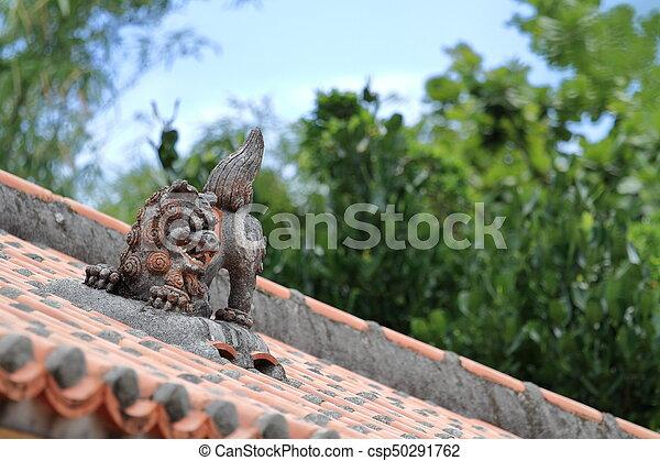 Shisa (guardian from Kingdom of Ryukyu) on the roof in Okinawa, Japan - csp50291762