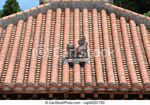 Shisa (guardian from Kingdom of Ryukyu) on the roof in Okinawa, Japan - csp50291763