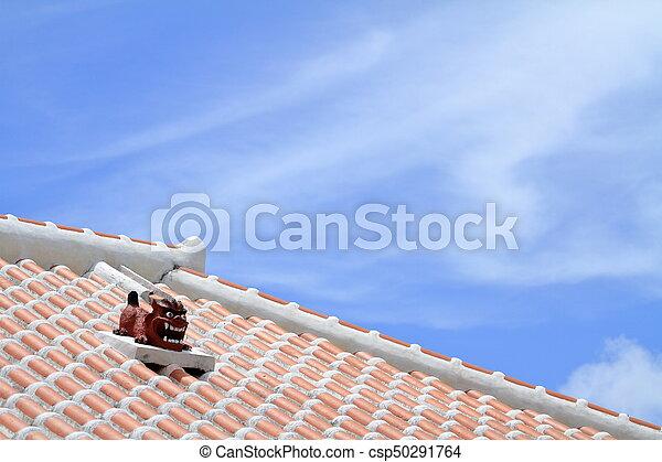 Shisa (guardian from Kingdom of Ryukyu) on the roof in Okinawa, Japan - csp50291764