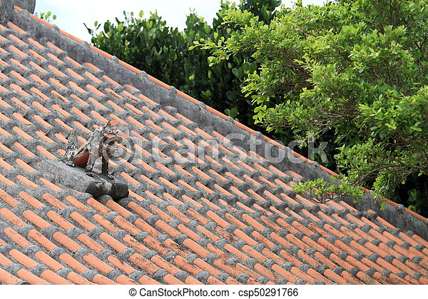 Shisa (guardian from Kingdom of Ryukyu) on the roof in Okinawa, Japan - csp50291766