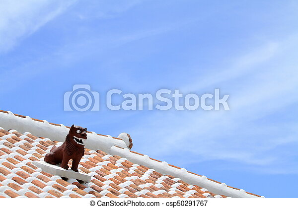 Shisa (guardian from Kingdom of Ryukyu) on the roof in Okinawa, Japan - csp50291767