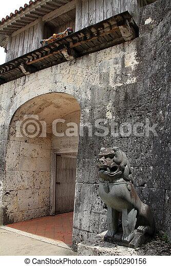 Shisa (guardian) in Shuri castle, Naha, Okinawa, Japan - csp50290156