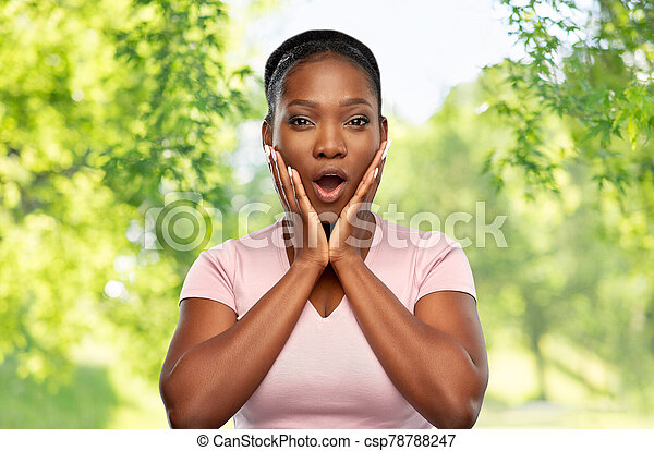 shocked african american woman with open mouth - csp78788247