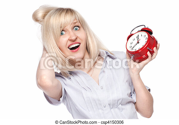Shocked beautiful young woman with alarm clock isolated on white - csp4150306