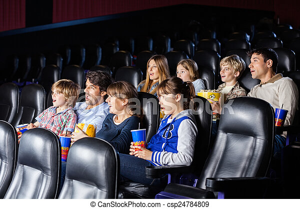 Shocked Families Watching Movie - csp24784809