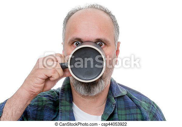 Shocked man with cup in front of face - csp44053922