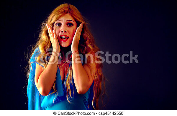 Shocked woman screaming with joyful. Surprised excited happy shouting girl. - csp45142558