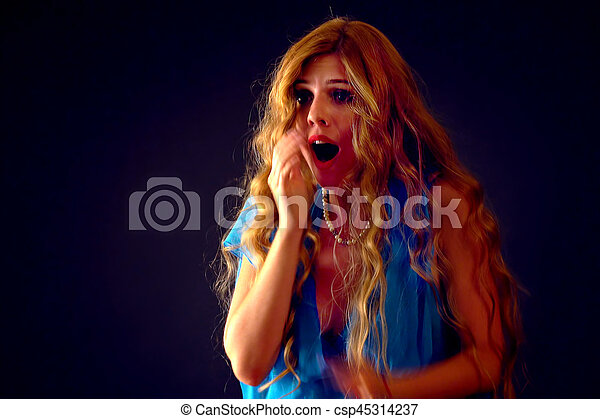 Shocked woman screaming with joyful. Surprised excited happy shouting girl. - csp45314237