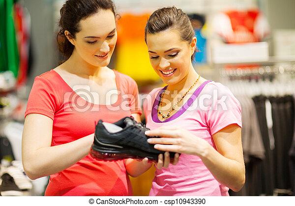 shop assistant helping customer - csp10943390
