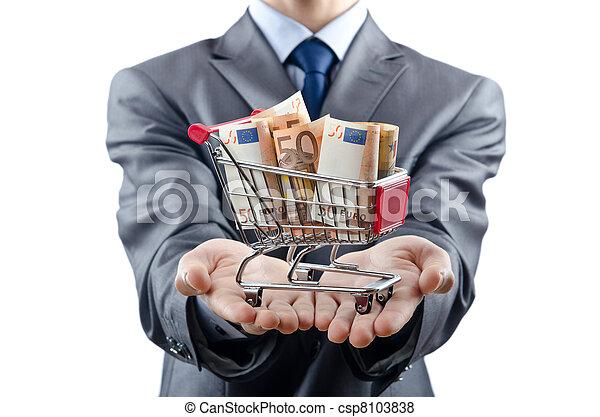 Shopping cart full of money - csp8103838