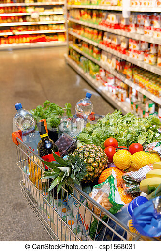Shopping cart with fruit vegetable food in supermarket - csp1568031