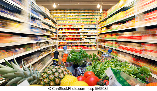 Shopping cart with fruit vegetable food in supermarket - csp1568032