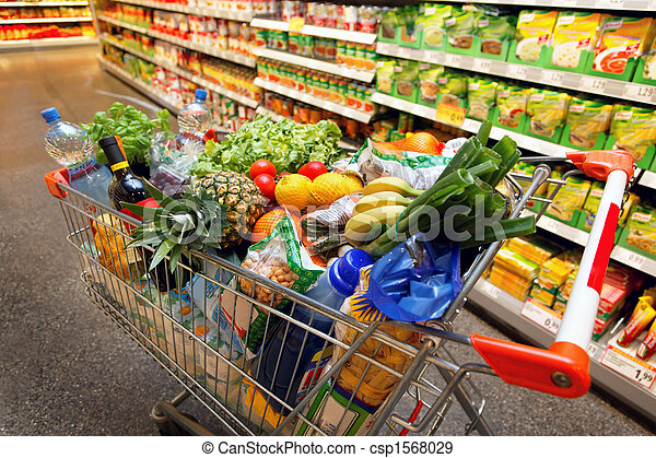 Shopping cart with fruit vegetable food in supermarket - csp1568029