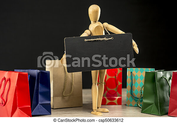 Shopping mannequin with a sign for copy space - csp50633612