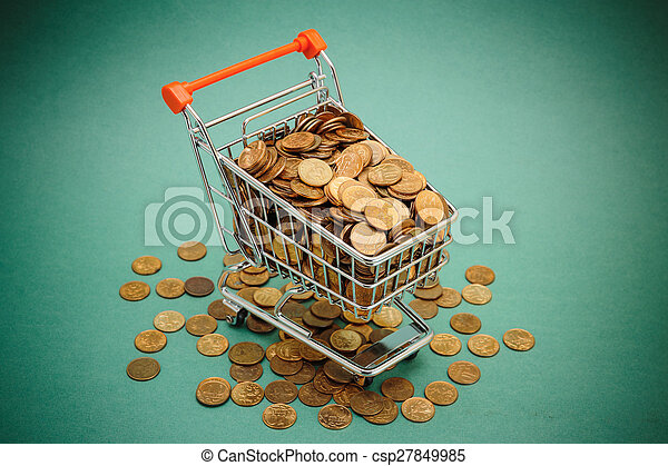Shopping trolley with coins on a green background - csp27849985