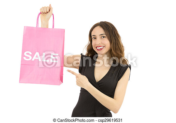 Shopping woman pointing to sale sign on a paper shopping bag - csp29619531