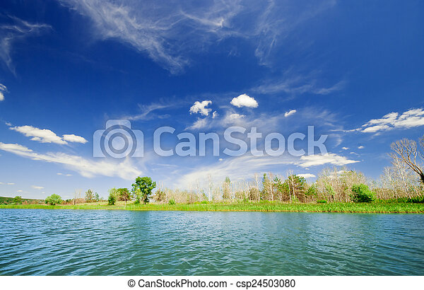 Shore of lake under sky - csp24503080