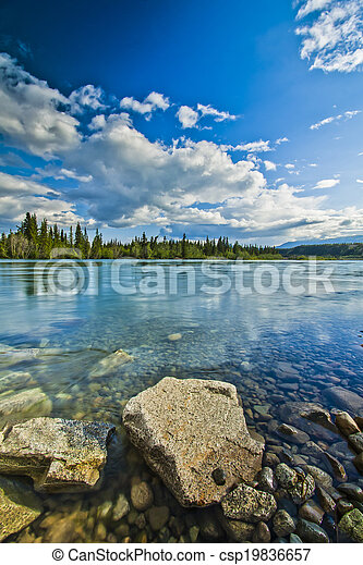 Shore of Yukon River - csp19836657