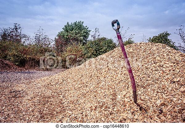 Shovel in mulch - csp16448610