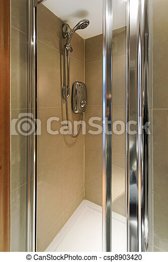 Shower. Small marble shower cabin with water heater.