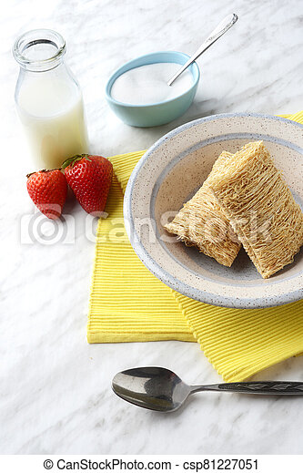 shredded wheat cereal with bottle of milk and strawberries - csp81227051