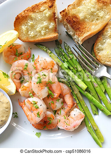 Shrimp and asparagus with garlic bread - csp51086016