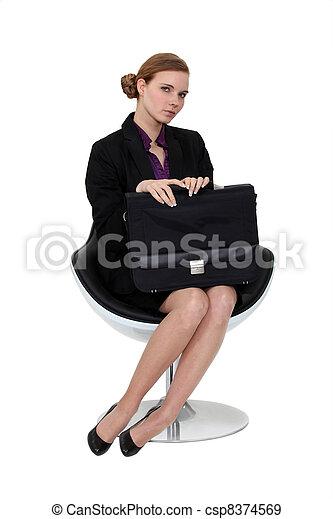 Shy applicant waiting in an armchair - csp8374569