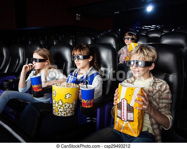 Siblings Watching 3D Movie In Theater - csp29493212