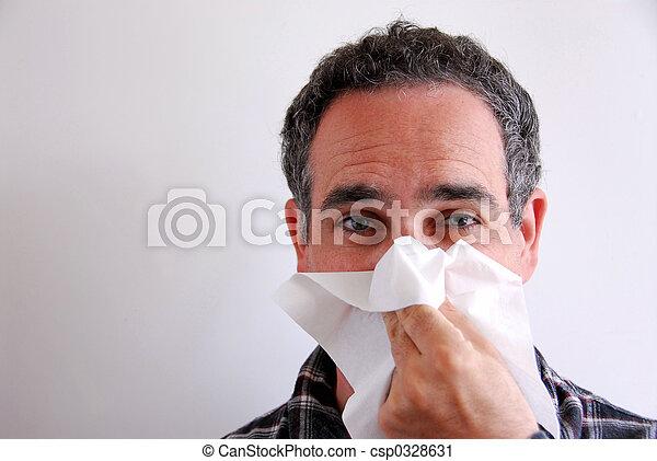 Sick man blowing nose - csp0328631