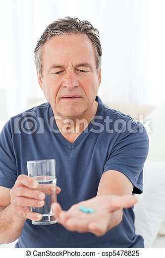 Sick man taking his pills - csp5478825