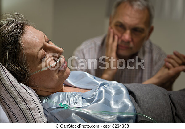 Sick mature woman lying in bed - csp18234358