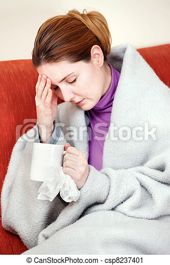 sick woman with a cup of tea in her hand - csp8237401
