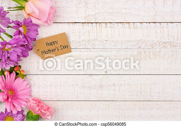 Side border of flowers with Mothers Day gift tag against white wood - csp56049085