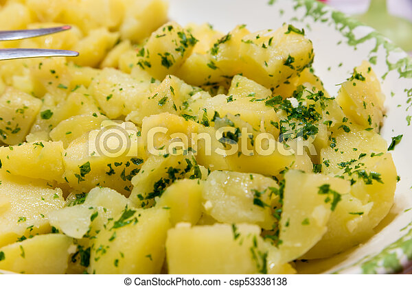 Side dish of boiled potatoes with parsley - csp53338138