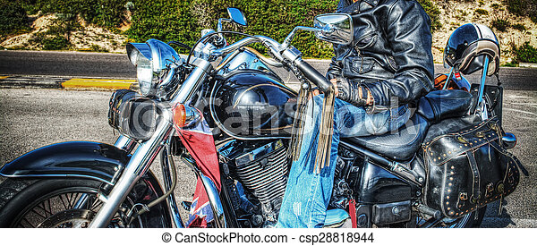 side view of a biker on a classic motorcycle - csp28818944