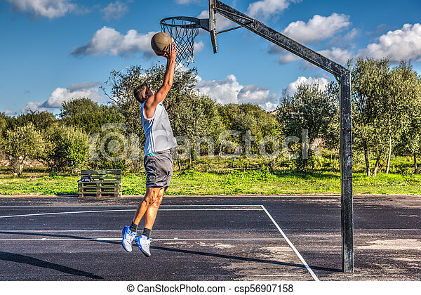Side view of a lefty basketball player - csp56907158