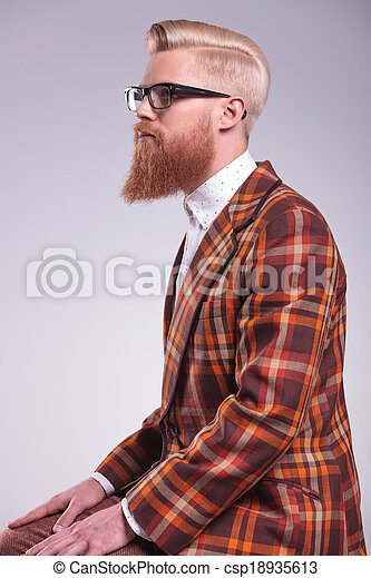 side view of a young fashion man with long beard  - csp18935613
