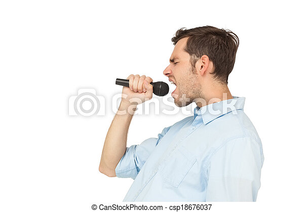 Side view of a young man singing in - csp18676037