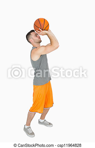 Side view of a young man throwing basketball - csp11964828